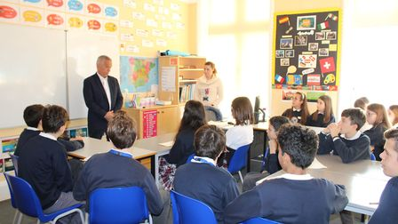 Sidmouth Town Council chairman Ian Barlow visited St John's to speak to students from Udine in Italy