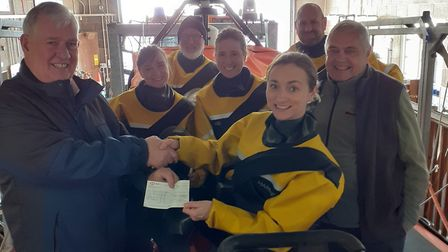 Keith Walton, president of Sidmouth Rotary Club, presents the cheque to Charli Ferrand of Sidmouth L