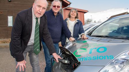 Stuart Hughes, Bob Weeks and Christine Winter with the electric car charging points at Stowford Rise