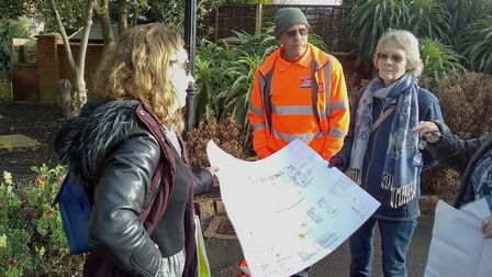 Carolyn Trussell from Natural Habitat Design discusses the plan with Alan Fowler from EDDC Parks and
