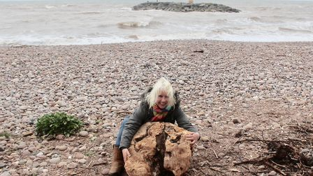 Artist Samantha Wakefield on the beach with the driftwood. Picture: Samantha Wakefield
