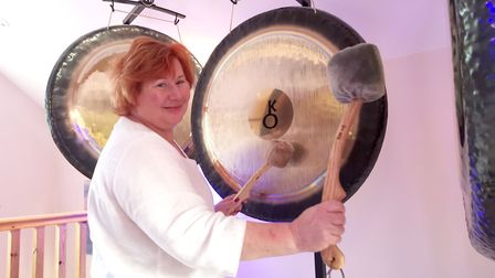 Debbie Tallis demonstrates a gong therapy session. Picture: Callum Lawton