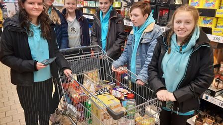 Members of Sidmouth Rangers buying items for the Sid Valley Food Bank. Picture: Sidmouth Rangers