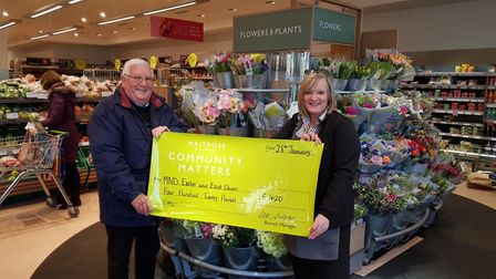 MND Exeter & East Devon volunteer Alan Smith receives the cheque from Julie Marish from Waitrose. Pi