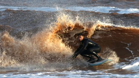 A surfer in action off Sidmouth. Picture; SIMON HORN