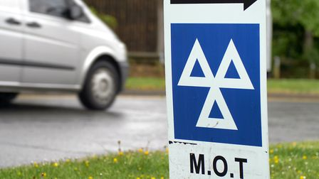 Blue MOT service sign on british road on cloudy rainy day. Picture: Getty Images