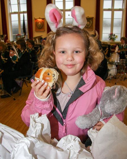 P2675-13-10TI Sidmouth great Bun giveaway was held in the St John's hall due to the weather.photo T