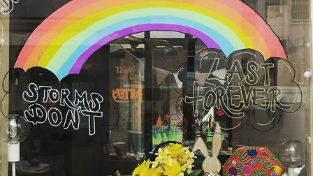 Colourful designs and positive messges on the window of Something Lovely. Picture: Em Swallow