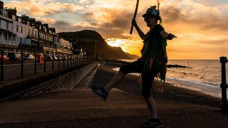 Alexa Baker greets the sun on Sidmouth seafront on May Day. Picture: Kyle Baker
