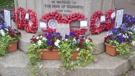 VE Day flowers at the base of the war memorial. Picture: Sidmouth In Bloom