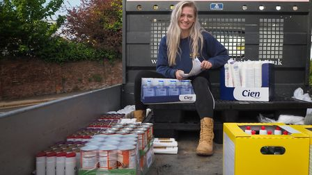Georgia King collecting wholesale purchases from Lidl, including essential cleaning products. Pictur