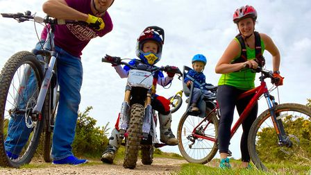 The Broughton family cycling on Woodbury Common during the 26Point2 Challenge. Picture: SRC