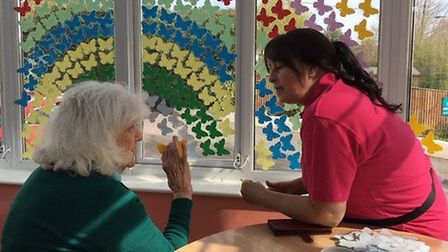 Residents at Malden House putting their art work up in the window. Picture: Maldon House