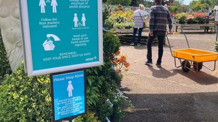 A notice reminding visitors to the garden centre to keep their distance and wash their hands. Pictur