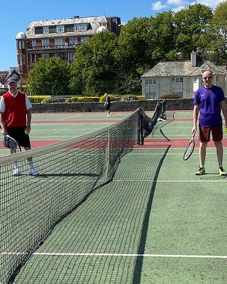 Sidmouth Tennis CluB's Peter Clark and Mark Heywood socially distanced as action returns to the club