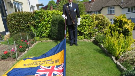 John Hayes, Royal British Legion standard bearer for Sidmouth, marks VE Day Picture: Margaret Hayes
