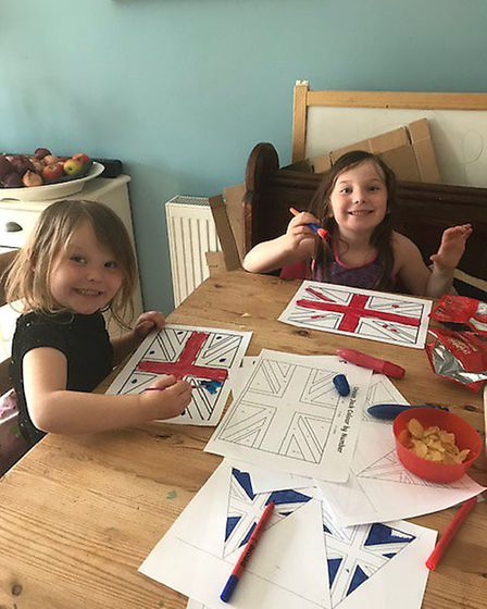 Lydia and Niamh Housden worked hard to make bunting for VE Day Picture: Claire Housden