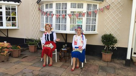 Beryl Jewes and Margaret Jewes enjoying some party food for VE Day celebrations Picture: Heather Bew