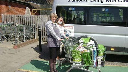 Driver Hazel collecting shopping from Margaret Edwards-Hughes, of Waitrose. Picture: Sidmouth Living