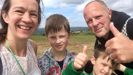 Young Mighty Green Seth Lancaster (centre left) has now got the Trig Point collecting bug and is doi