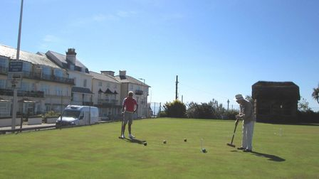 Ed Dolphin and Duncan Hasell enjoying a match on lawn four at Sidmouth Croquet Club. Picture: PHILIP