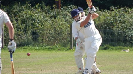Louis Adey hits out during his knock of 70 in the Sidmouth III meeting with Bradninch 2nds.