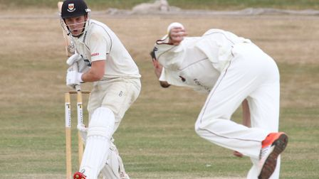 Sidmouth 2nds batsman Dec Lines faces a delivery from Exmouth's Sean Butler at the Maer on Saturday.