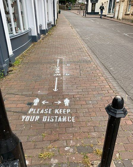 Signs have been stencilled on the pavements around Sidmouth. Picture: Stuart Hughes