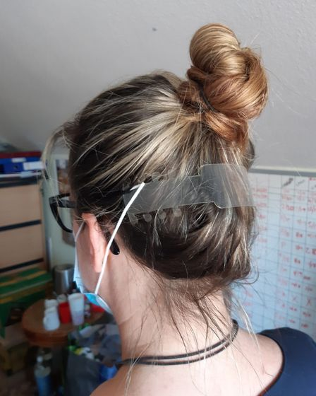 Samantha Evens wearing her mask clip. Picture: Amy Burt