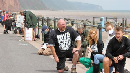 Participants take the knee on Sidmouth seafront. Picture: Paul Ryder