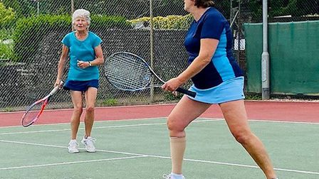 Carole McCallum and Nikki Keele with eyes on the ball. Picture: SIDMOUTH TENNIS CLUB
