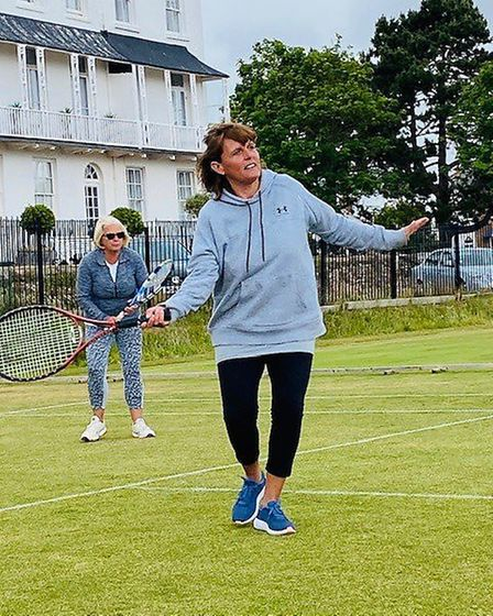 Debbie Snelgrove adopts a balletic pose for a sweeping forehand on the grass. Picture: STC