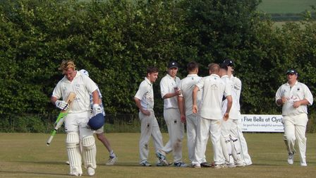 Dan Powell begins the walk back to the pavilion after his innings of 95 atBradninch