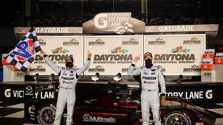 Harry Tincknell (right) after his success at Daytona in the first race back since the Covid-19 enfor