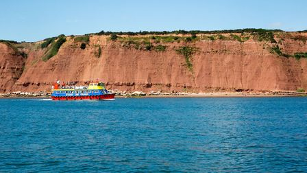 The Stuart Line boat passing spectular red cliffs. Picture: Daniel Smith, Stuart Line Cruises