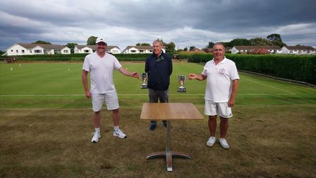 Peter Nelson presenting the winners trophies to Stuart Smith (left) and Steve Leonard. Pictur: PHILI