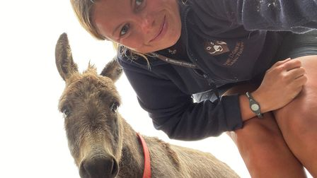 Groom Angharad Hall with Shadow. Picture: The Donkey Sanctuary