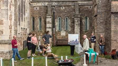A picture of Ottery Church and a wheelbarrow filled with red wine were presented to the Revd Weston.