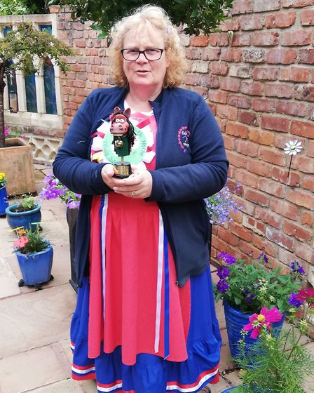 Liz Clode of the Sidmouth Steppers with the winners' trophy. Picture: Kyle Baker