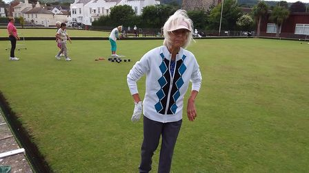 Sidmouth bowler Sheila taking part in the Sunset Umbrella meeting. Picture; CAROL SMITH