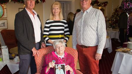 Frances Meek celebrating her 100th birthday with her sons Christopher and Melvyn and daughter June.