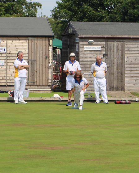 Celia Russell sends a wood down the green during the competition. Picture; OSMBC