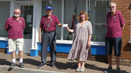 Lions Club president Chris Rignall presents the cheque to Carol Drover-Taylor of SVS, with fellow Li