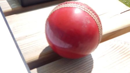 A cricket ball on the scorers table.