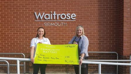The presentation to FORCE Cancer Charity. Picture: Waitrose