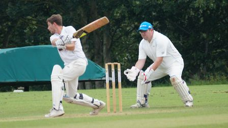 John Buckland hits out in the Tipton game at Whimple, a match which saw him score 38, hold two catch