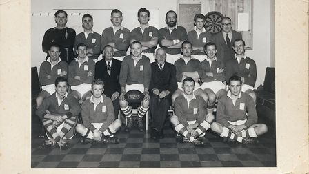 The 1962/63 Sidmouth RFC team including Brian Thomas with the ball, Derek Marchant standing third le