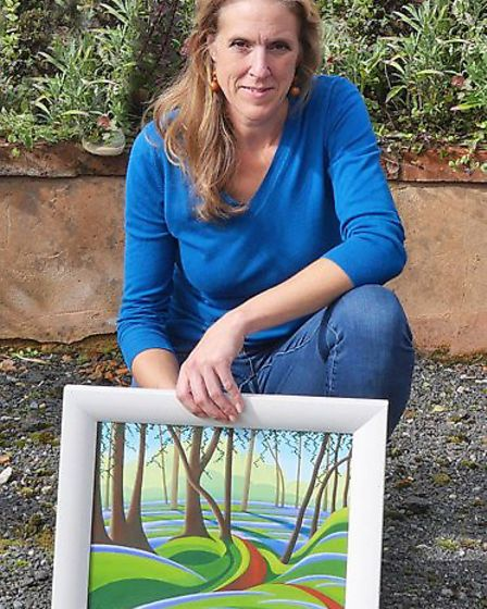 Victoria Goodman with one of her landscape paintings