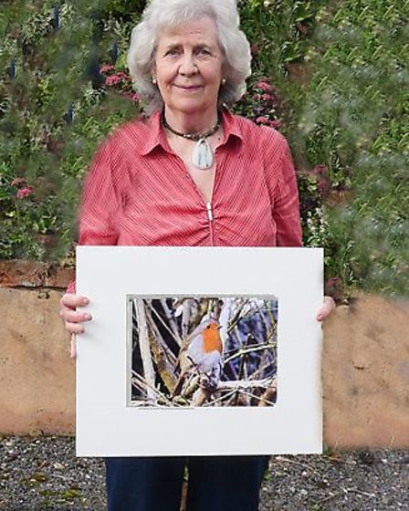 Judith Stephens with one of her wildlife images
