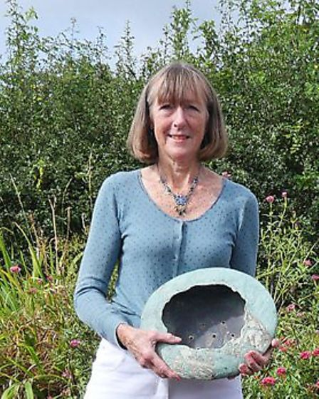 Candy Robinson with one of her textured pots